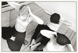 Three women, seen from above, in a yoga position